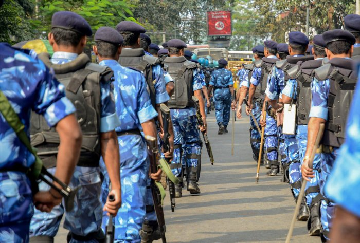 Rapid Action Force (RAF) personnel keep vigil as activists of All Assam Students Union students participate in Satyagraha rally against amendments in Citizenship Act. PTI