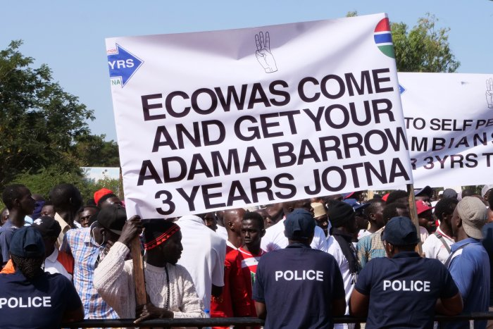 rotesters hold a banner as they take part in a demonstration against Gambian President, in Banjul, Gambia. (AFP Photo)