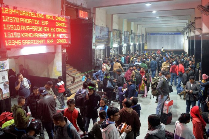 Commuters wait as trains has been cancelled at New Jalpaiguri Railway station on the outskirts of Siliguri. (AFP Photo)