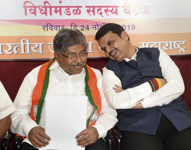 BJP Maharashtra President Chandrakant Patil and BJP leader Devendra Fadnavis. (PTI Photo)