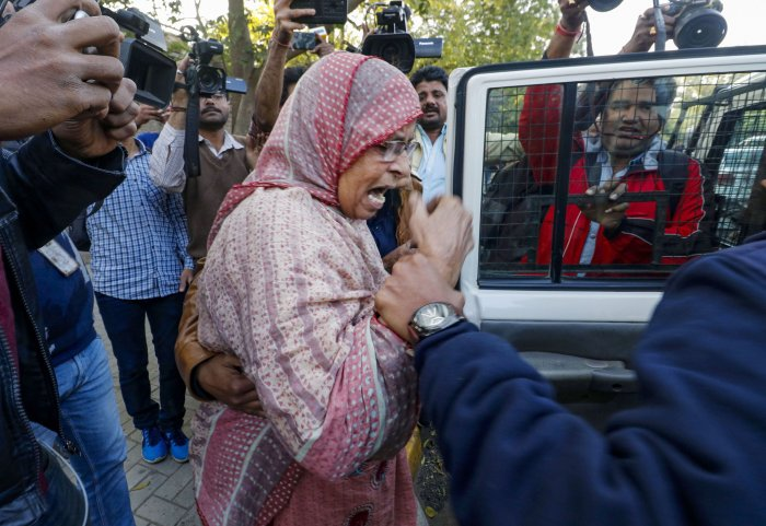 Police detain a demonstrator during a protest to show solidarity with the students of Delhi's Jamia Millia Islamia who are agitating over the Citizenship Amendment Act, in Ahmedabad. (PTI Photo)