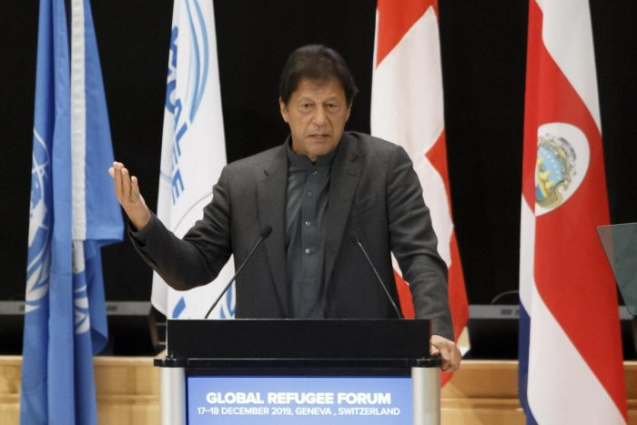 Pakistan's Prime Minister Imran Khan delivers a speech during the UNHCR - Global Refugee Forum at the European headquarters of the United Nations in Geneva. AP/PTI