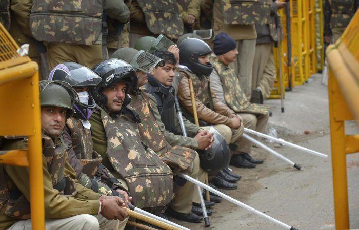 Police personnel deployed in the Jamia Nagar area following yesterday's protest against the Citizenship Amendment Act (CAA) at Jamia Millia Islamia, in New Delhi, Monday, Dec. 16, 2019. (PTI Photo)