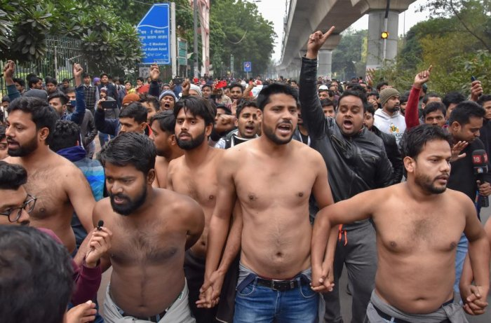 """Slogans of """"Inquilab Zindabad"""" rent the air as the group of around 10 students, accompanied by their fellow colleagues, took out a small march, demanding a CBI inquiry into the """"police brutality"""". Photo/PTI"""