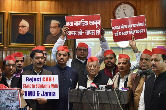 Samajwadi Party MLCs interact with mediapersons after staging a protest on student clashes over CAA, during the first day of the Winter session of the State Assembly. PTI