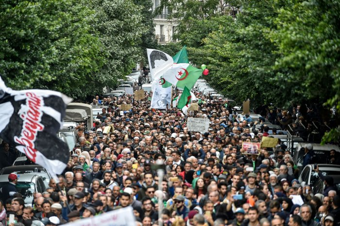 People gather for a mass anti-government demonstration in the centre of the Algerian capital Algiers. (AFP Photo)