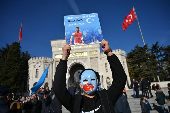 """Arsenal footballer Mesut Ozil, a German national of Turkish origin, tweeted that the Muslim world has been silent on the plight of the Uighurs in a message on the flag of """"East Turkestan,"""" which Uighur separatists call the western Chinese region of Xinjiang. Photo/AFP"""