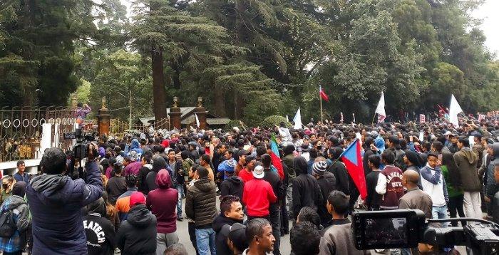 Protestors take part in an agitation against the passing of Citizenship Amendment Bill, infront of Raj Bhavan in Shillong, Meghalaya. (PTI Photo)