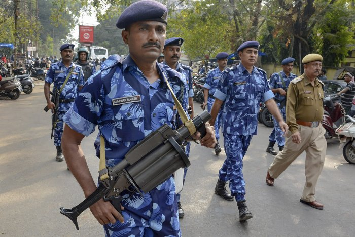 Rapid Action Force (RAF) personnel keep vigil as activists of All Assam Students Union students participate in Satyagraha rally against amendments in Citizenship Act. (PTI Photo)