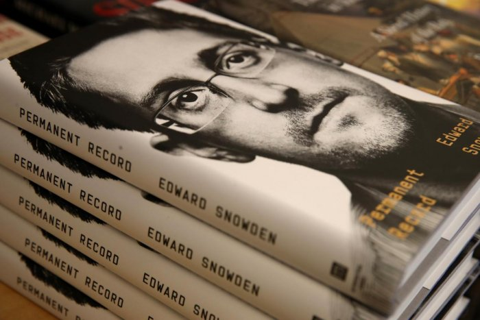 In the book, Snowden explains how he viewed himself as a whistleblower by revealing details about the government's mass collection of emails, phone calls and internet activity in the name of national security. Photo/AFP