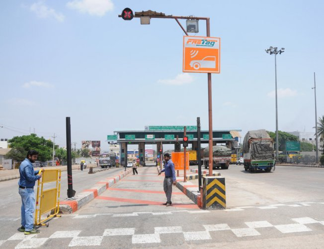 Authorities at toll plazas are grappling with several issues over FASTags. DH file photo