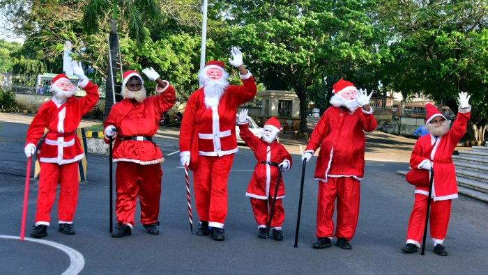 Children dressed as Santa Claus for the Christmas and Deepavali celebrations organised by MLC Ivan D'Souza at Town Hall in Mangaluru.