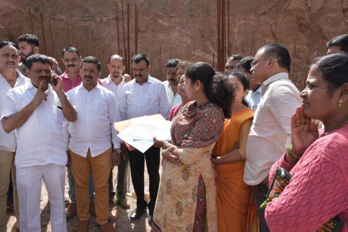 MLA Appachu Ranjan and MLC Sunil Subramani visit the site of 'Madikeri Square' on Tuesday.