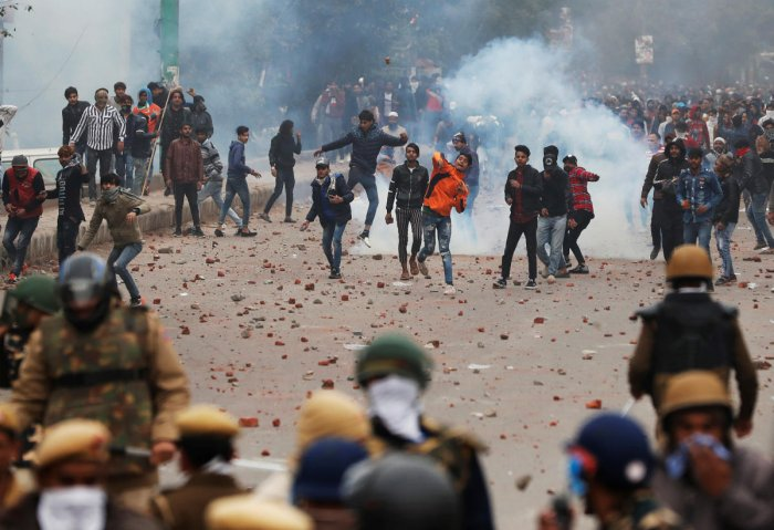 Protestors indulge in stone-pelting during an anti-CAA protest in Seelampur, Delhi, on Tuesday. Reuters