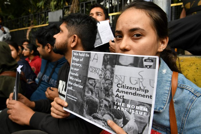 Protesters shout slogans and hold placards at the Town Hall during a demonstration held against India's new citizenship law in spite of a curfew in Bangalore on December 19, 2019. (AFP Photo)