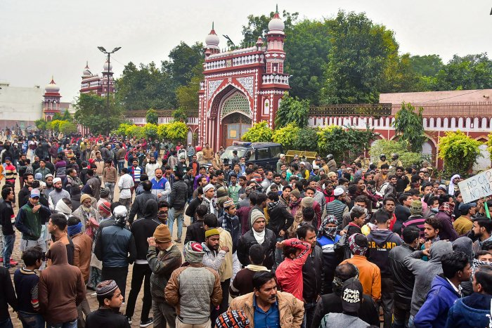 People gather at the Eidgah to protest against the alleged police action on AMU students who were protesting over Citizenship Amendment Act, in Aligarh, Monday, Dec. 16, 2019. (PTI Photo)