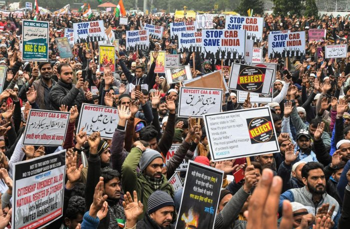 Protesters hold placards as they raise slogans during a demonstration against NRC and Citizenship (Amendment) Act (CAA) outside Jama Masjid, in Chandigarh
