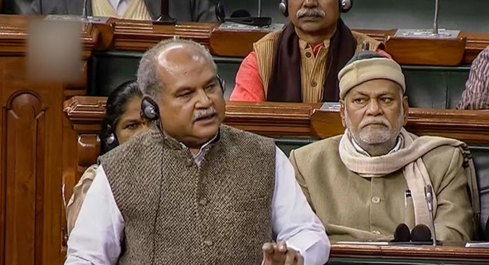 Union Agriculture Minister Narendra Singh Tomar speaks in the Lok Sabha during the ongoing Winter Session of Parliament. LSTV/PTI