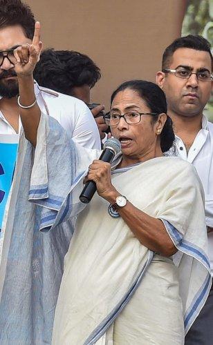 Kolkata: West Bengal Chief Minister Mamata Banerjee addresses a protest rally against NRC and Citizenship Amendment Act, in Kolkata, Monday, Dec. 16, 2019. (PTI Photo)