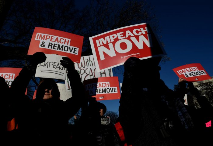 People rally in support of the impeachment of US President Donald Trump in front of the US Capitol, as the House readies for a historic vote on December 18, 2019 in Washington, DC. (AFP Photo)