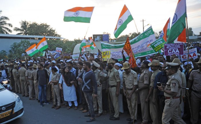 People protest against CAA at Bannerghatta Main Road in Bengaluru on Wednesday.   DH Photo: Pushkar V