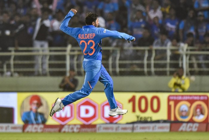 India bowler Kuldeep Yadav celebrates after completing his hat-trick during the 2nd ODI cricket match against West Indies at ACA-VDCA Cricket Stadium in Visakhapatnam. Photo/PTI
