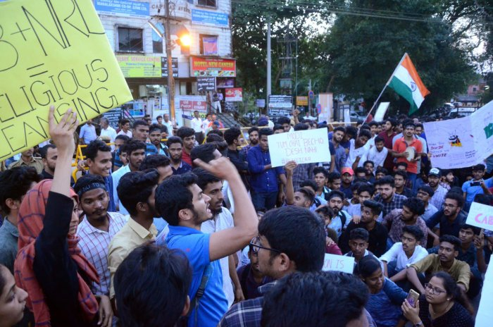 Students shout slogans and stage protests against the Citizenship Amendment Act. (DH Photo)