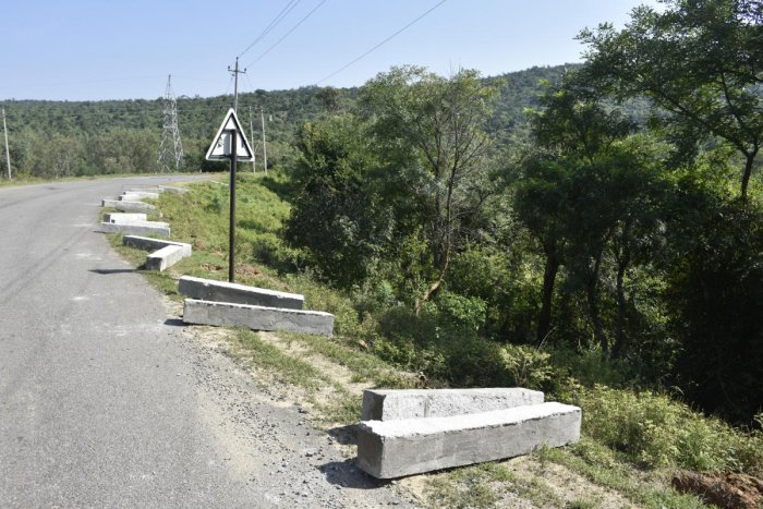 Cement pillars lie on the road at Boredaddi near Budipadaga of Kollegal taluk.