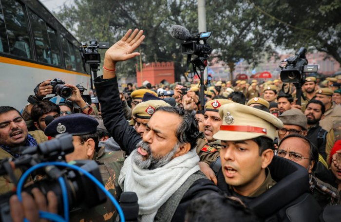 Swaraj Abhiyan founder and activist Yogendra Yadav is detained by police for defying prohibitory orders imposed by the Delhi Police in the area during an anti-Citizenship Act protest, at Red Fort, in New Delhi, Thursday, Dec. 19, 2019. (PTI Photo)