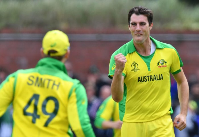 Australia's Pat Cummins (R) celebrates taking a wicket during the 2019 Cricket World Cup. Credit: Saeed Khan/AFP