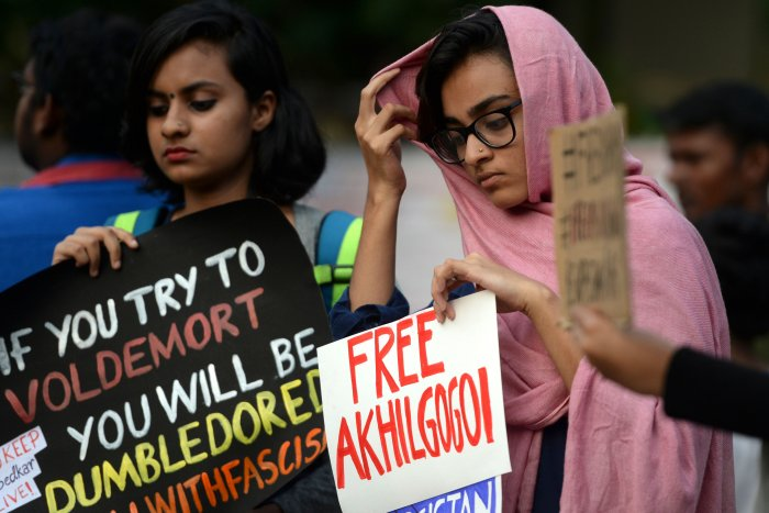 Students and demonstrators hold placards and shout slogans during a protest against India's new citizenship law. (AFP Photo)