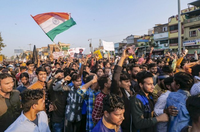 Protestors raise slogans during a demonstration against Citizenship Amendment Act (CAA), in Ahmedabad. (PTI photo)