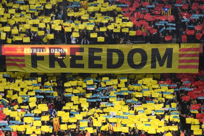 Barcelona supporters wave a banner reading Freedom during the El Clasico on Wednesday. AFP