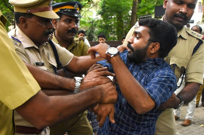 A protestor being detained by police personnel during a rally against the amended Citizenship Act, in Kochi. (PTI photo)
