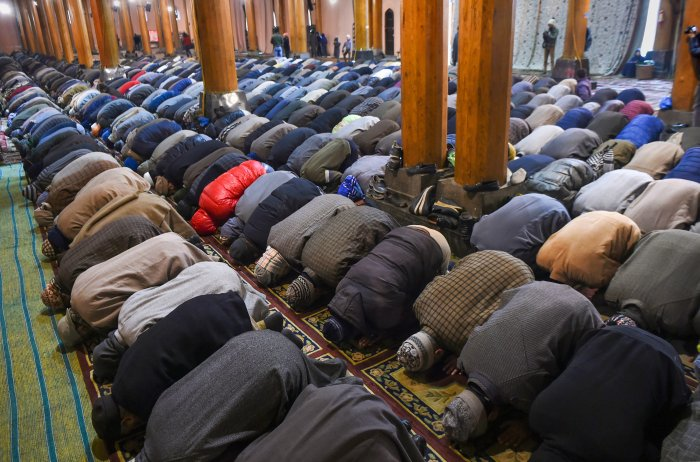 People offer congregational prayers at historical Jamia Masjid, in Downtown Srinagar. (PTI Photo)