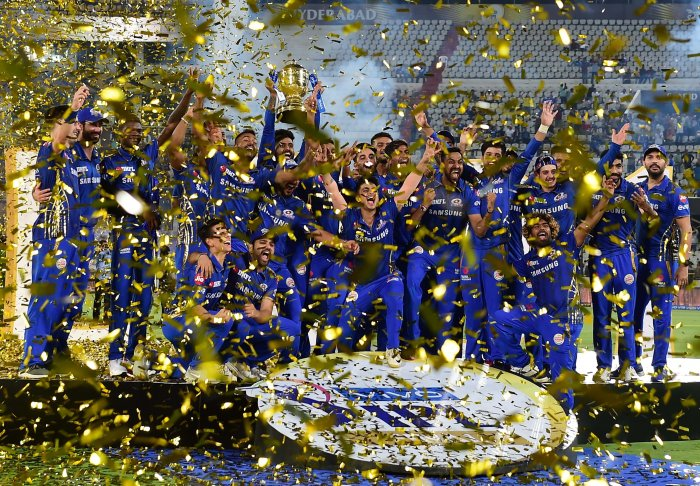 Mumbai Indians (MI) skipper Rohit Sharma with his teammates celebrating with Indian Premier League 2019 winning trophy after win over Chennai Super Kings (CSK) at the Final cricket match at Rajiv Gandhi International Cricket Stadium in Hyderabad, Monday, May 13, 2019. (PTI Photo)