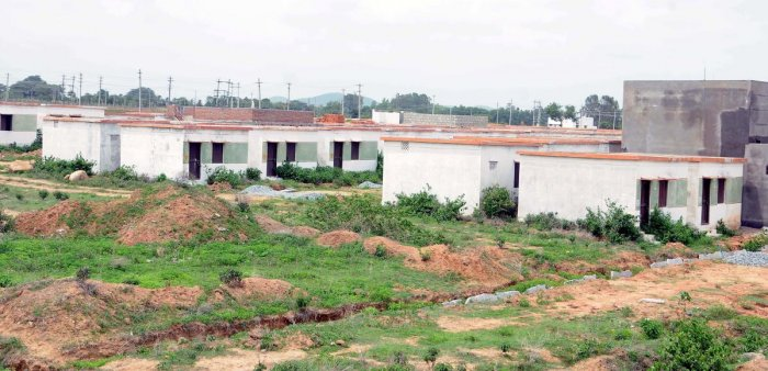 Houses built under Ashraya housing scheme. The Gram Panchayat Hakkottaaya Andolana has opposed govt's decision saying the proposed monitoring committees would undermine the right and power of GPs as local self-government. DH FILE PHOTO