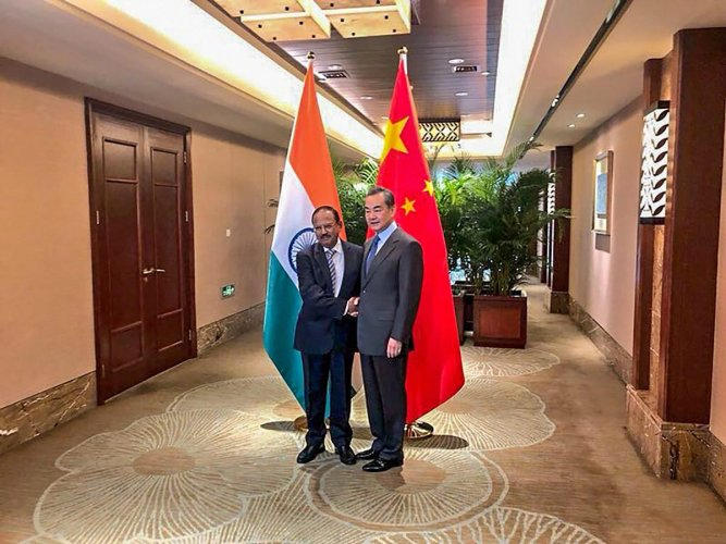 The Chinese delegation will be led by its Foreign Minister Wang Yi, while National Security Advisor Ajit Doval will head the Indian team at the boundary talks beginning on Saturday. Photo/PTI