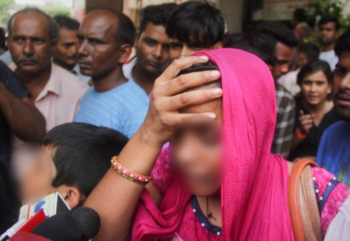 A relative of the Unnao rape survivor talks to the media outside KGMC Hospital where she is being treated, in Lucknow, Monday, July 29, 2019. The rape survivor got injured in a road accident near Raebareli, Sunday. (PTI Photo)