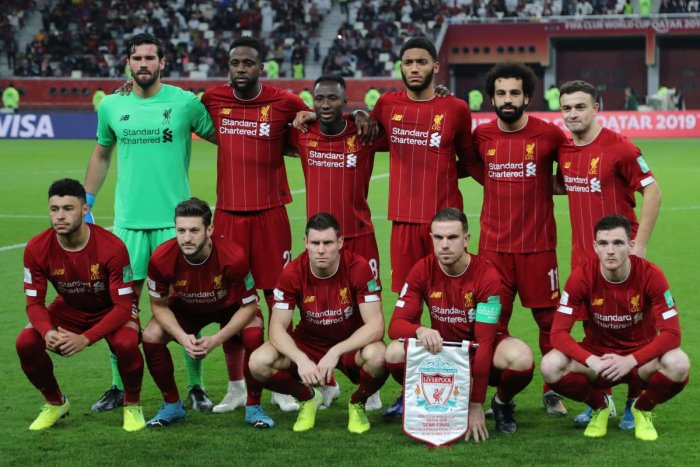 England's Liverpool team poses for a group picture in the 2019 FIFA Club World Cup at the Khalifa International Stadium in Doha. AFP