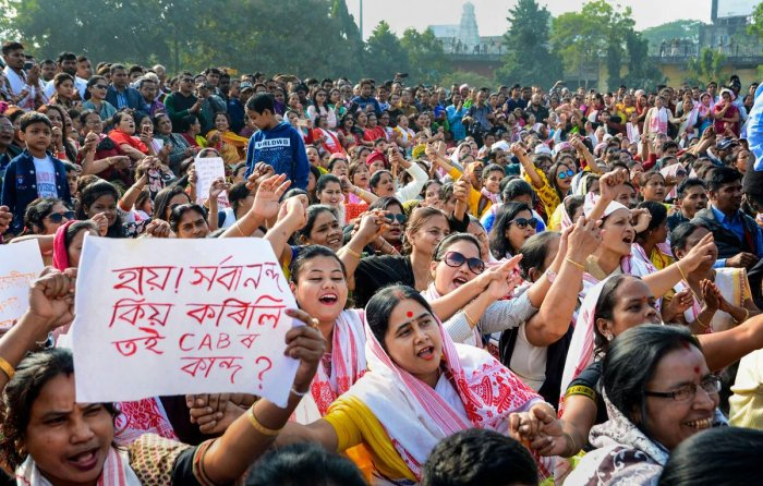 Protesters raise slogans during a protest against the Citizenship Amendment Act (CAA) at the AEI field in Guwahati. Photo/PTI
