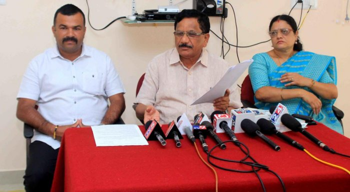 Virajpet MLA K G Bopaiah addresses a press meet in Madikeri on Thursday. DH Photo