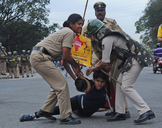 Cops detain people protesting against CAA near Town Hall in Bengaluru on Thursday.   DH Photo: Pushkar V