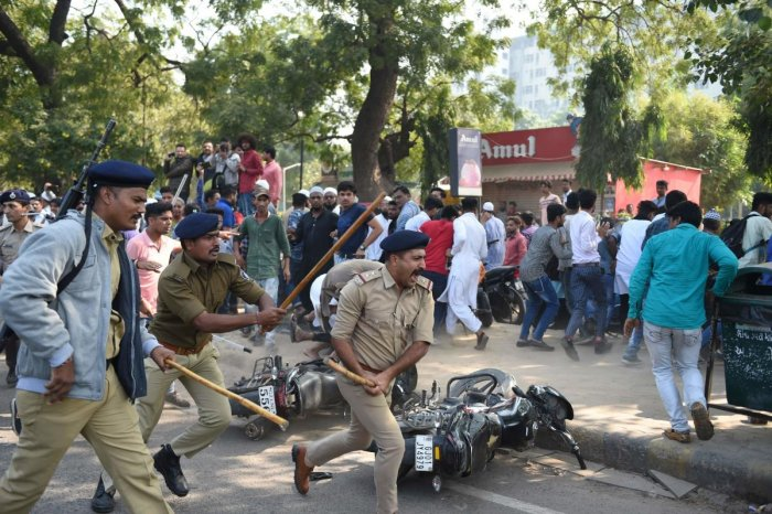 Gujarat police react to disperse protesters during a demonstration against India's new citizenship law in Ahmedabad (Photo by AFP)