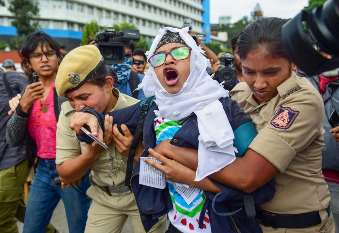While the police were busy breaking up small groups of protesters in the morning, a 500-strong group of men and women waving the national flag and placards condemning the Citizenship Amendment Act (CAA) swarmed the road closer to the SJ Park at 12.30 pm. (PTI Photo)