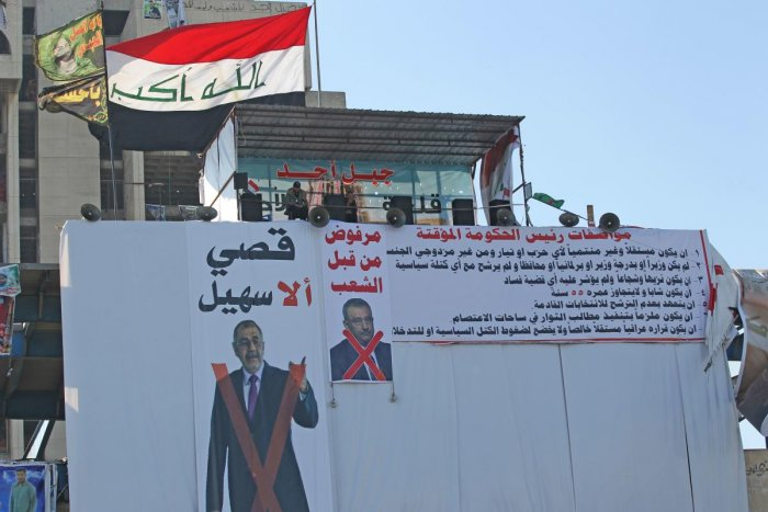 Amid ongoing anti-government protests in Tahrir square of Baghdad, protestors display the faces of the rejected candidates crossed out in red on the posters.