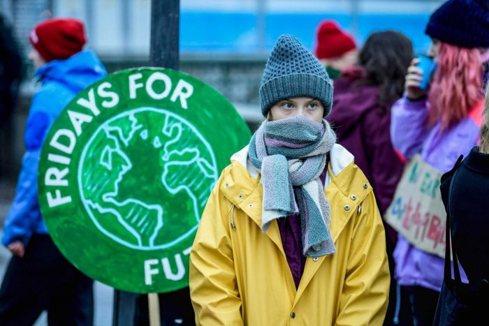 """Swedish environmental activist Greta Thunberg attends a climate strike arrangd by the orgatisation """"Fridays For Future"""" outside the Swedish parliament Riksdagen in Stockholm, December 20, 2019. (Photo by AFP)"""