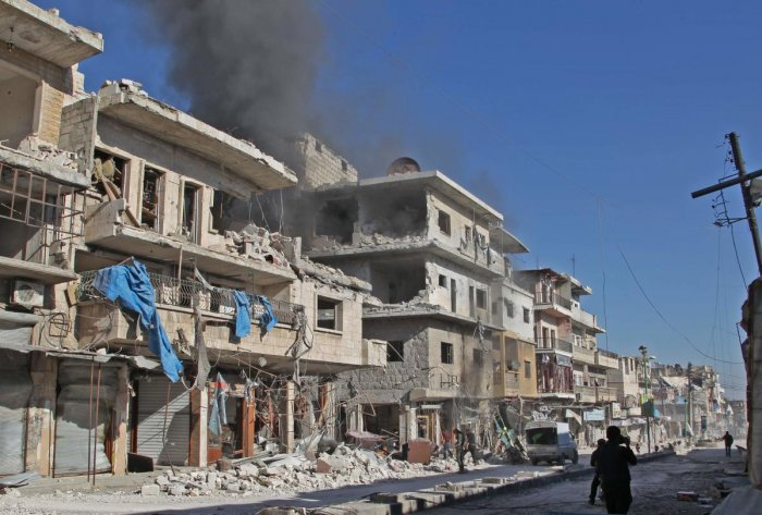 Smoke billows from a building following a reported bombardment by pro-Syrian government forces in the town of Maaret al-Numan in Syria's Idlib province, the country's last major opposition bastion, on December 20, 2019. (Photo by AFP)