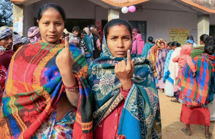 oters display their fingers marked with indelible ink after casting their votes during the fifth phase of the Jharkhand Assembly elections, in Godda district
