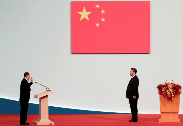 Macau Chief Executive Ho Iat-seng takes an oath in front of Chinese President Xi Jinping at a ceremony on the 20th anniversary of the former Portuguese colony's return to China in Macau. Reuters